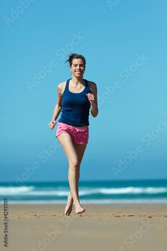 Fotobehang womenART Girl running on the beach in barefoot