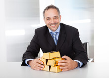 Businessman With Golden Bars