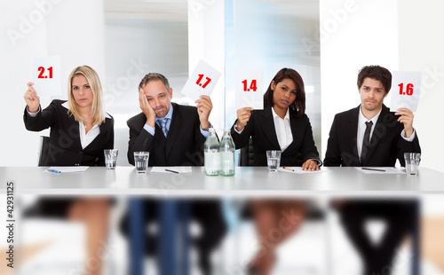 Valokuva  Panel judges holding bad score signs
