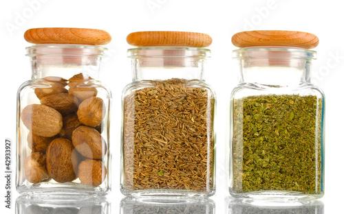 Printed kitchen splashbacks Spices powder spices in glass jars isolated on white