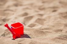 Baby Bucket And Shovel On The Sandy Beach