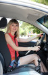 Happy smiling blonde woman in car