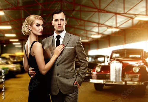 Couple in retro garage - 42965048