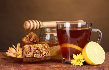 Fototapeta honey, lemon, honeycomb and a cup of tea