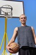Basketball player posing in front of backboard