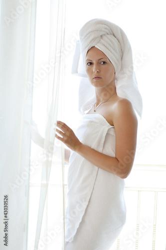 Fototapeta young woman in white towels obraz na płótnie