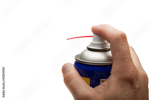 Fotografía  hand pushing spray can. isolated over white background