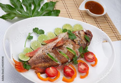 Tuinposter Kruidenierswinkel Whole Roasted Wild Rockfish