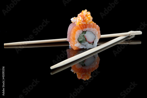 Foto op Canvas Sushi bar sushi with chopsticks over black background