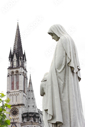 Photo  center of pilgrimage to famous cathedral in Lourdes, France