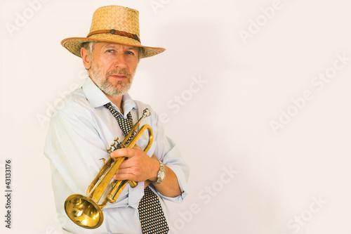 Photo  Trumpeter in a straw hut