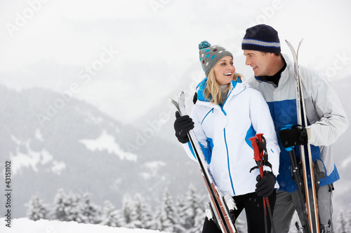 Fotografía  Middle Aged Couple On Ski Holiday In Mountains