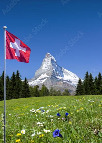 Fotografie, Obraz  Matterhorn mit Schweizer Flagge