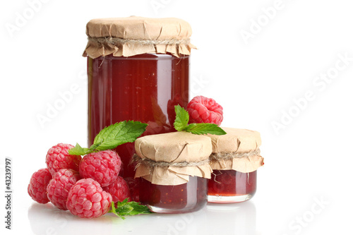 Fényképezés  jars with jam and ripe raspberries with mint isolated on white
