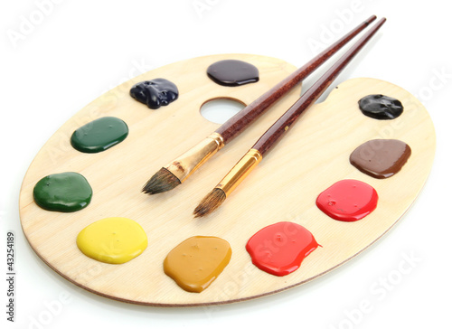 Fotografie, Obraz  wooden art palette with  paint and brushes.isolated on white