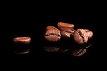 Luxurious Coffee Beans On Black.