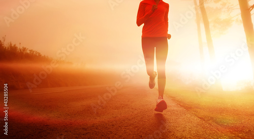 Sunrise running woman Wallpaper Mural