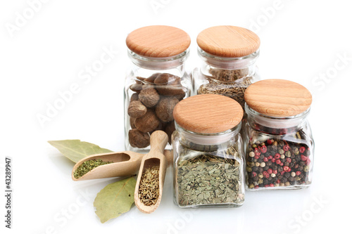 Foto op Canvas Kruiden 2 jars and wooden spoons with spices isolated on white