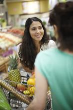 Women Talking In Grocery Store