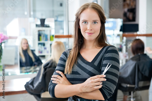 Smart Female Hairdresser Holding Scissor