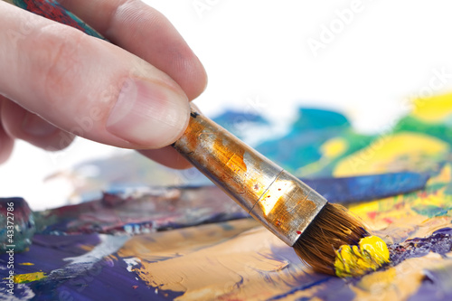 Somebody is painting some picture with paintbrush, isolated