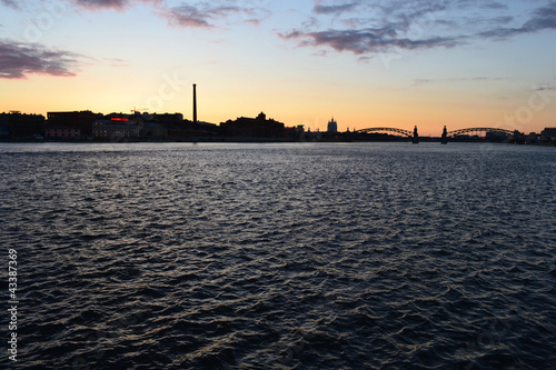Spoed Foto op Canvas Zee zonsondergang Neva river at sunset, St.Petersburg
