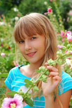 Young Girl In The Garden Of Mallows