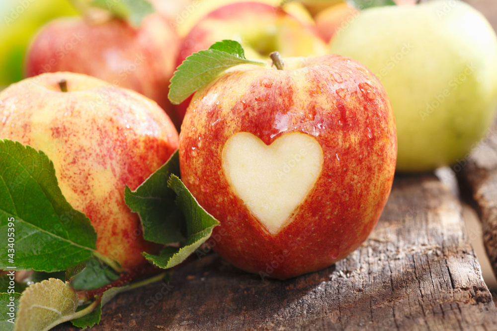 Fototapety, obrazy: Fresh red apple with heart cutout