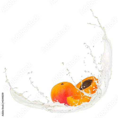Foto op Canvas In het ijs Milk splash with apricots isolated on white