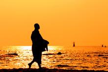 Silhouettes Of Monks On The Beach,Hua Hin Thailand