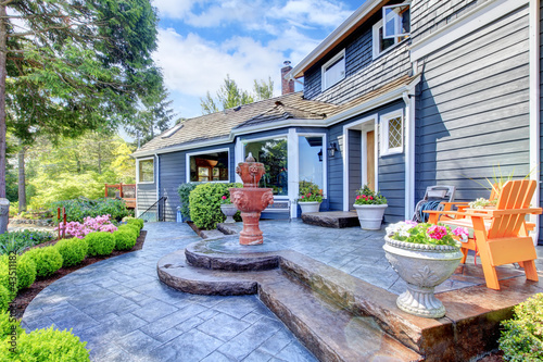 Blue house entrance with fountain and nice patio. - Buy this stock ...