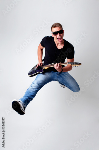 Fototapeta  Rockstar leap with guitar