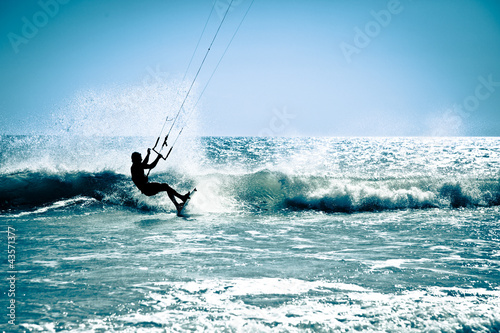 Kite surfing in waves. #43571377