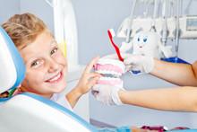Happy Child With Toy Dentures