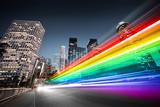 Fototapeta Tęcza - Colorful rainbow bus traffic blur in city