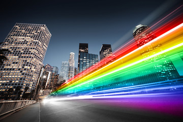 Colorful rainbow bus traffic blur in city