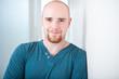 Leinwanddruck Bild - Closeup portrait of happy young man smiling isolated on white ba