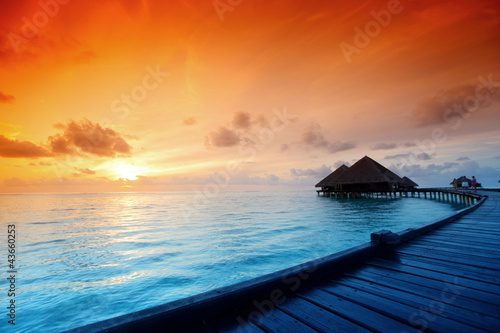 maldivian houses on sunrise - 43660253