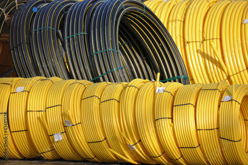 Stock black and yellow coiled plastic pipes Wallpaper Mural