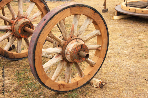 Fotobehang Indiërs repair of an old wooden wheel of a cart