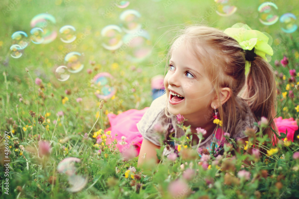 Fototapety, obrazy: Happy little girl playing with bubbles