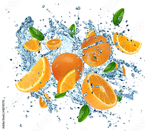 Poster Eclaboussures d eau Fresh oranges in water splash on white background.