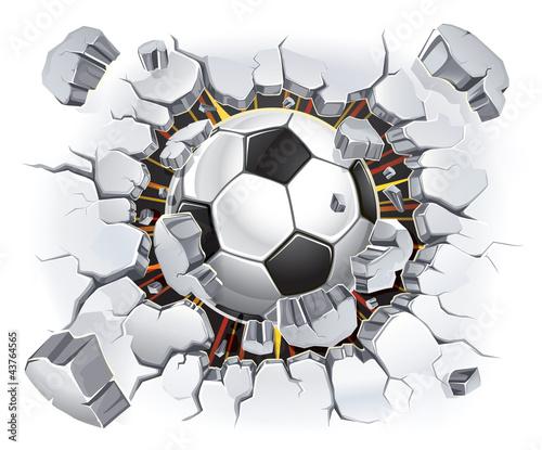 Fototapeta Piłka przebijająca mur XL