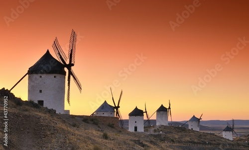 Poster Corail Windmills in Consuegra, Spain.