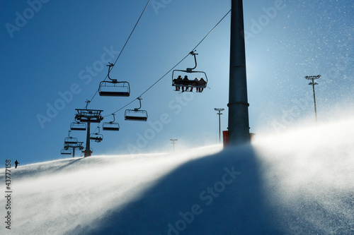Photographie  backlit scenes with ski lift chairs