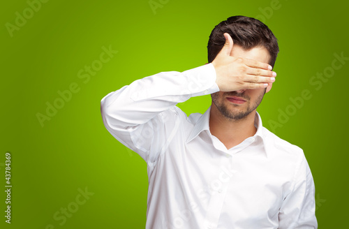Fotografie, Obraz  Portrait Of An Businessman Covering Eyes