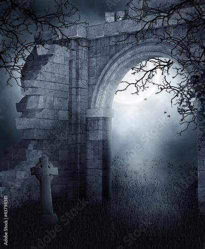 Fototapeta Ruiny cmentarnej bramy nocą obraz