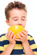 Little boy eatich grapefruit with pleasure