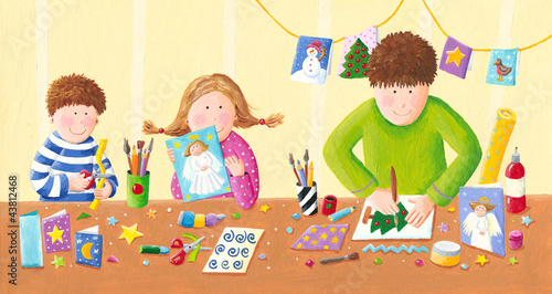 Happy family making Christmas postcards - 43812468