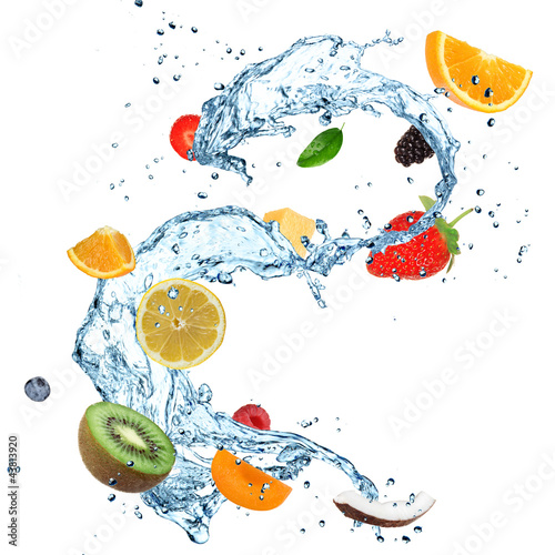 Poster Opspattend water Fruit in water splash over white